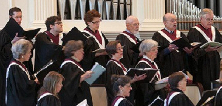 The choir singing in the choir loft